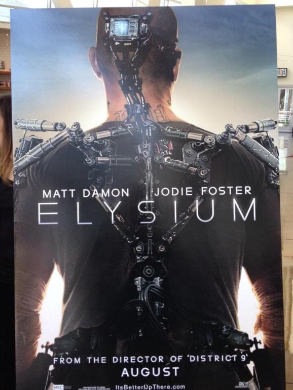 Elysium Movie Poster Showcases Damonu0026#39;s Exoskeleton : Giant ...