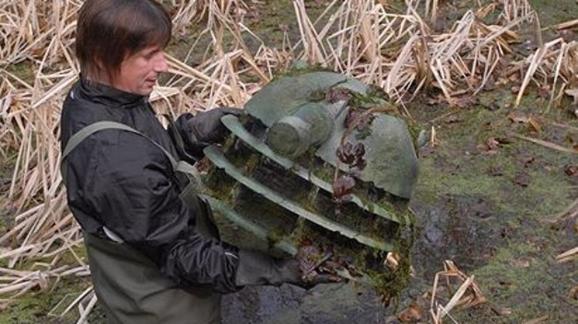 Dalek lurking in a muddy pond in UK