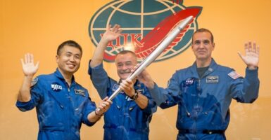 iss olympic torch