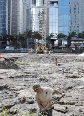 Archaeologists dig for ancient artifacts at a construction site in downtown Miami